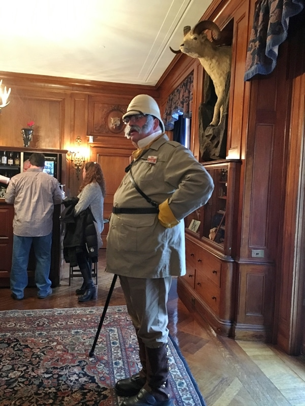 A man dressed as Colonel Mustard from Clue