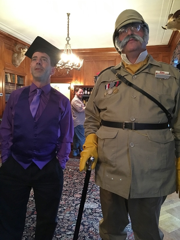 men dressed as Professor Plum and Colonel Mustard from Clue