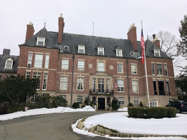 a large brick building with snow in front