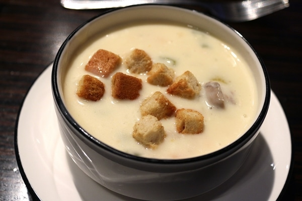 A bowl of creamy soup with croutons
