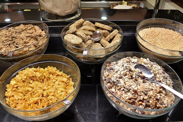 large bowls of granola and cereal on a buffet line
