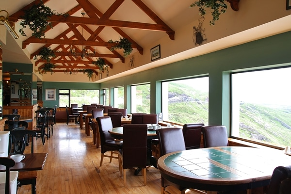 an empty restaurant dining room with large windows