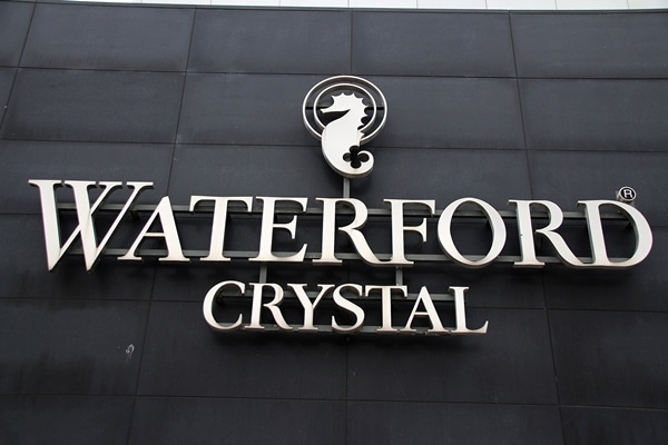 A sign on the side of a building that says Waterford Crystal