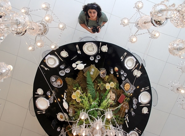 view looking down at a woman and a table display
