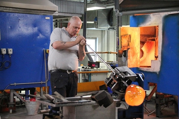 A man blowing glass