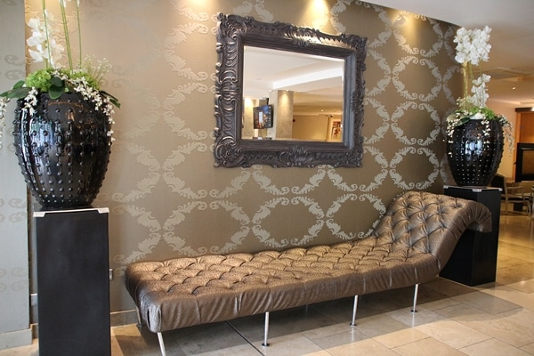 a chaise lounge and mirror