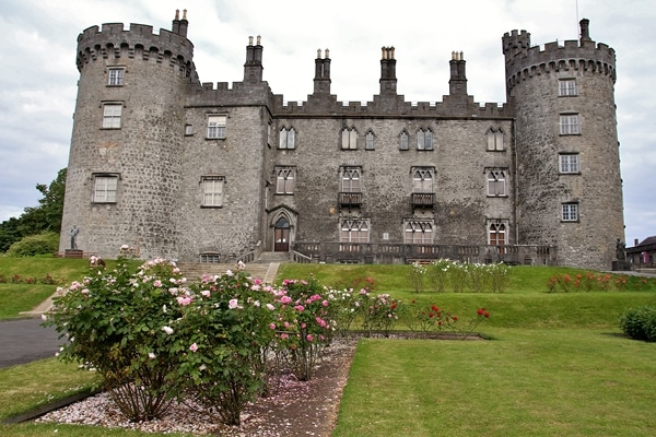 Exterior of Kilkenny Castle with gardens in front