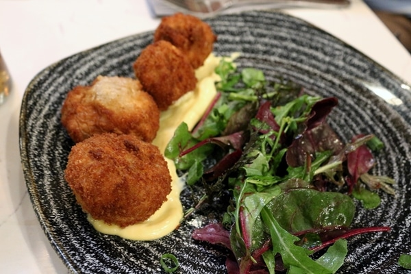 fried mushrooms on a plate with salad