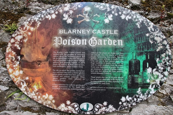 A close up of a sign that says Poison Garden