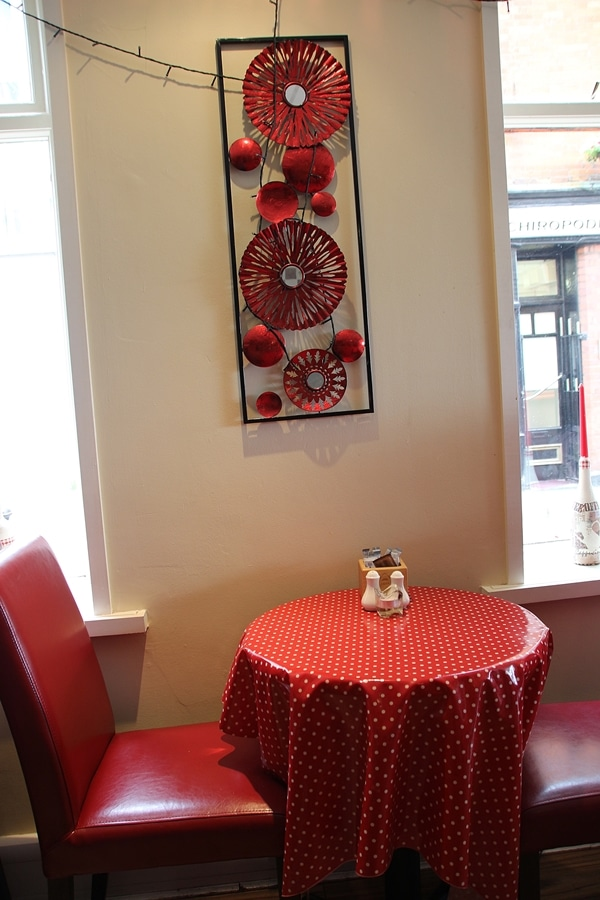 a red chair and red covered table in a restaurant