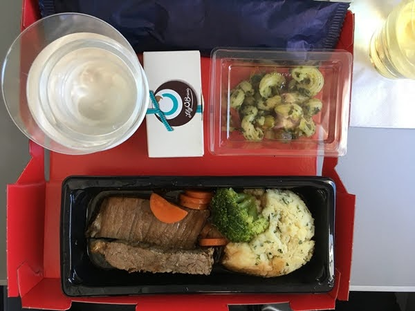 airplane food on a tray table