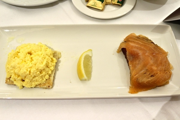 toasts topped with scrambled eggs and smoked salmon