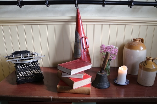 a table with books and a typewriter