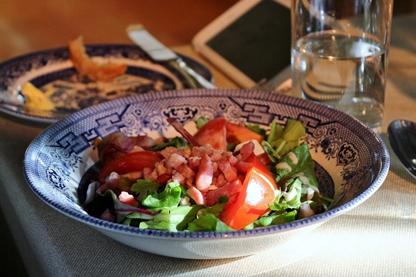 salad in a blue and white bowl