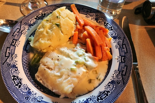A plate of food with fish and carrots