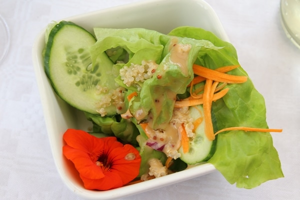 A bowl of salad with cucumbers