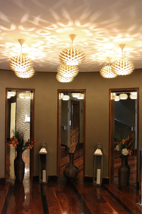 a room with tall mirrors and funky lights