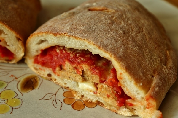 A close up of a cross section of a meatball calzone