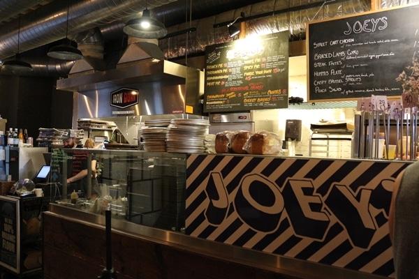 a food stall with a blackboard menu
