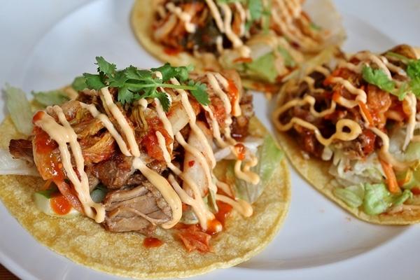 3 kimchi pork tacos on a plate