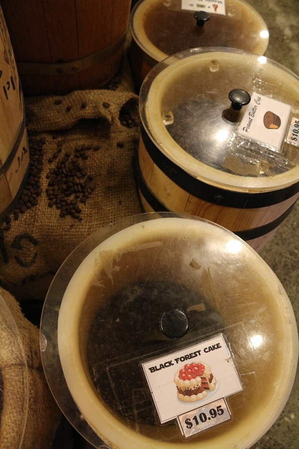 closeup of barrels of coffee beans