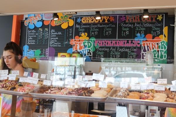 a donut shop with a colorful blackboard menu
