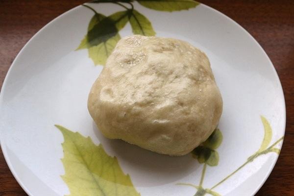 a steamed bun on a plate