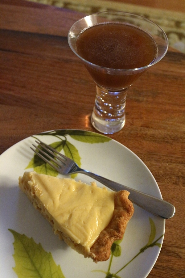 a slice of pie and a cocktail in a glass