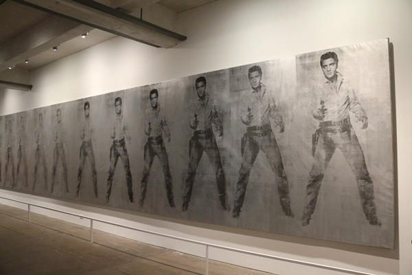 a row of paintings of Elvis Presley