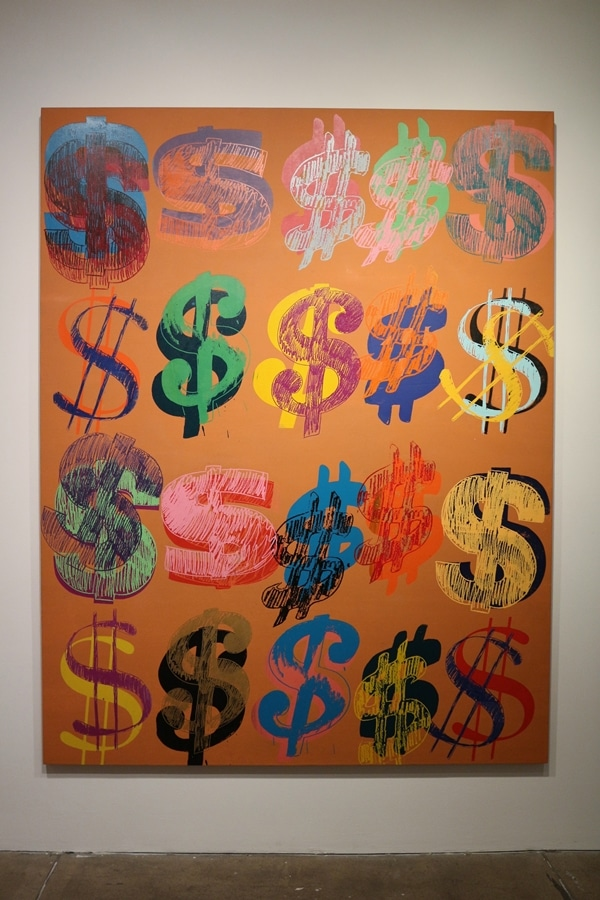 a painting of various dollar signs in different colors