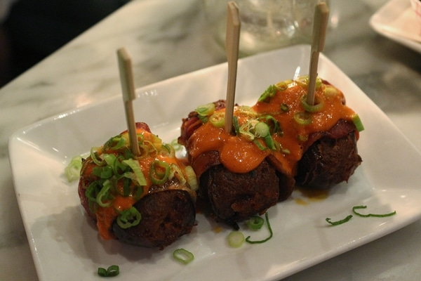 stuffed dates topped with sauce