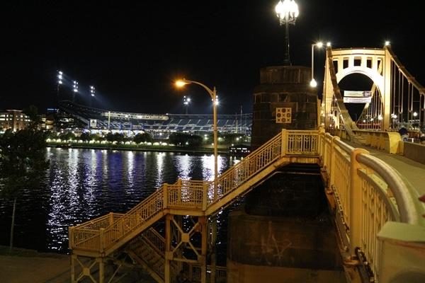 A bridge over a river at night