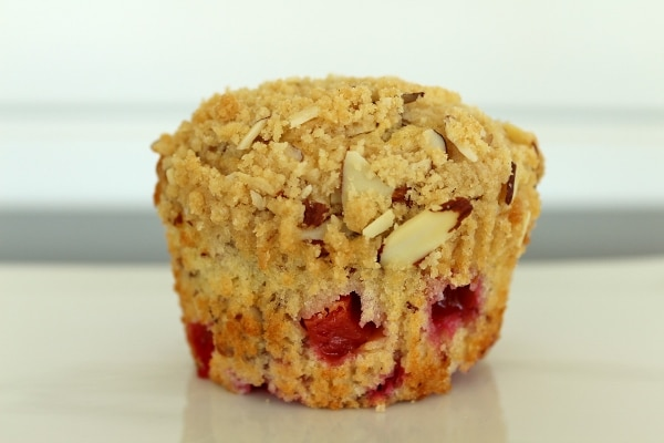 A close up of a plum and almond muffin