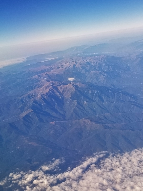 A view of a mountain from an airplane window