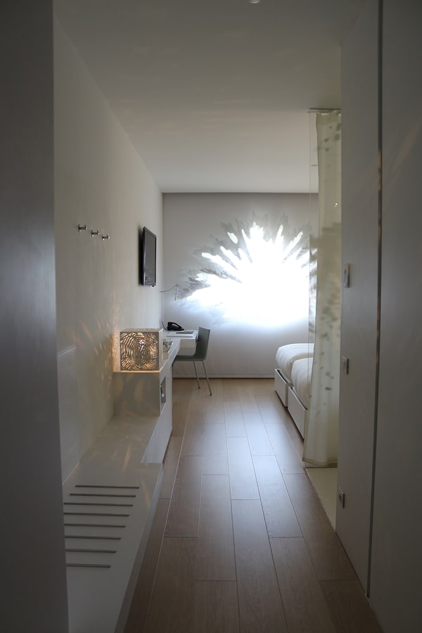 a hotel room with a palm shaped window