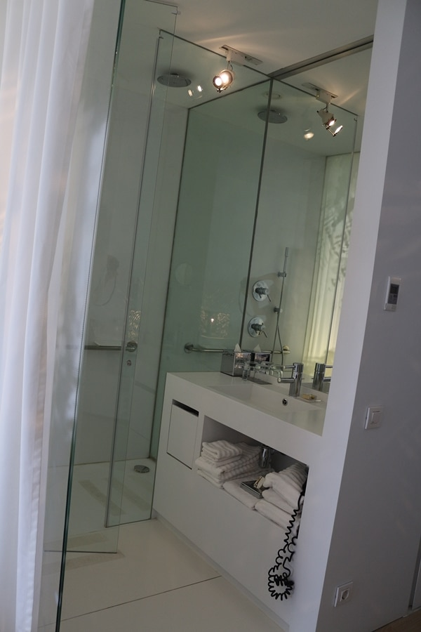 A hotel shower and sink