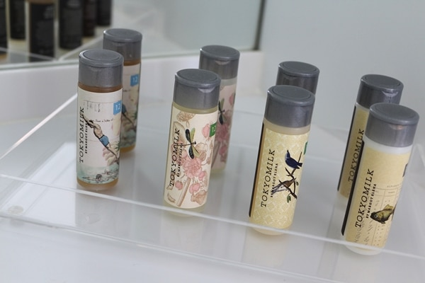 A close up of small bottles of shampoo