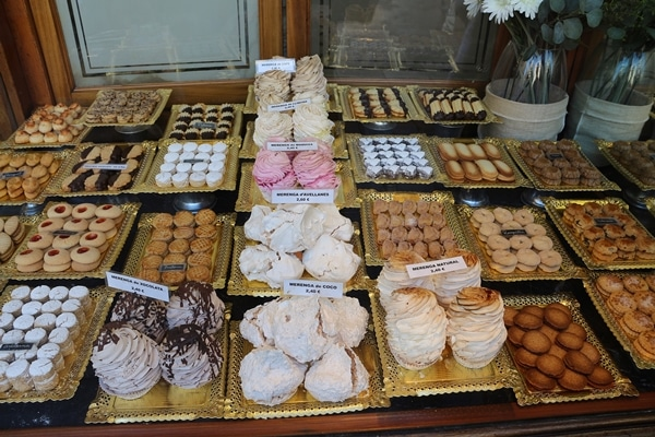 a chocolate and pastry display in a shop