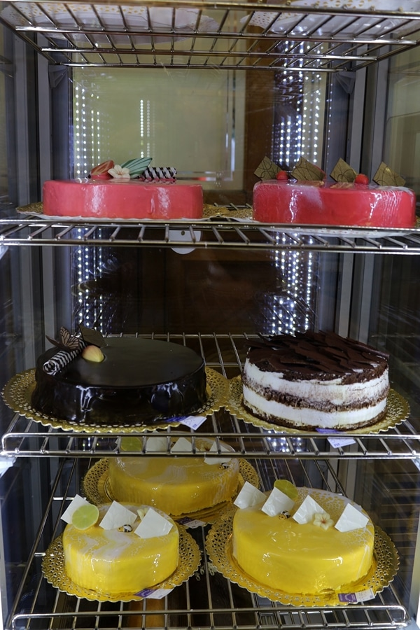 cakes in a bakery display