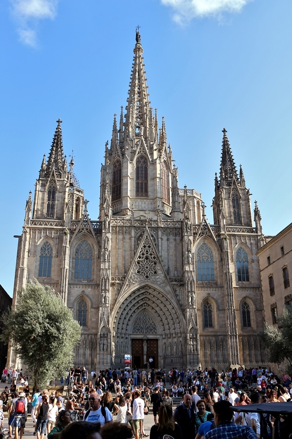 A group of people standing in front of Barcelona Cathedral