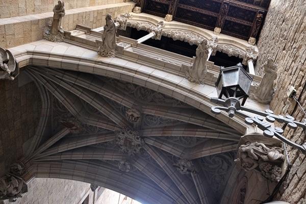 view looking up underneath gothic bridge