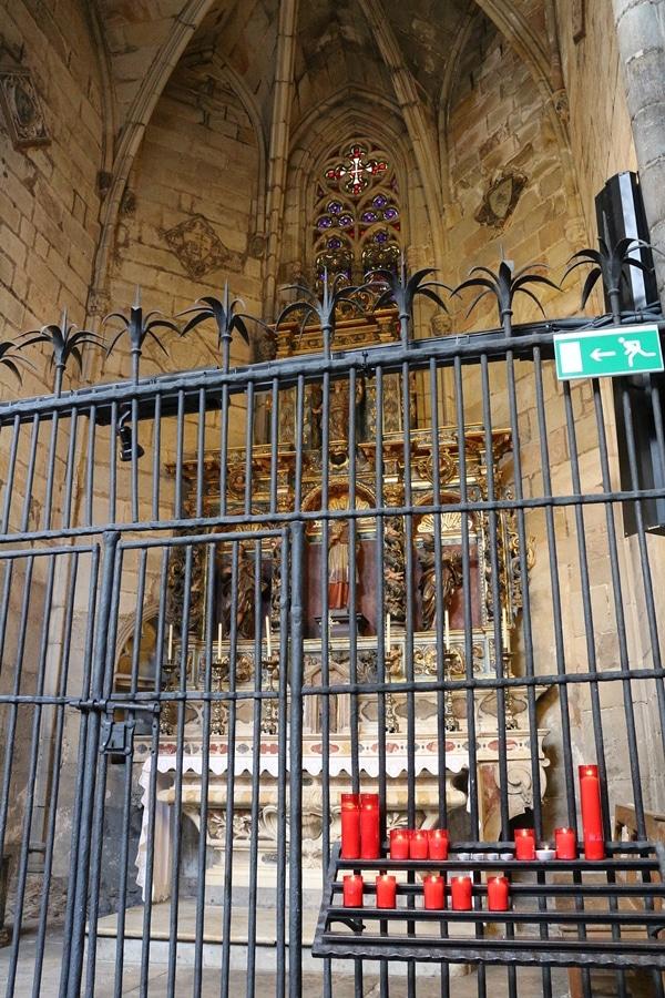 an altar behind a metal fence