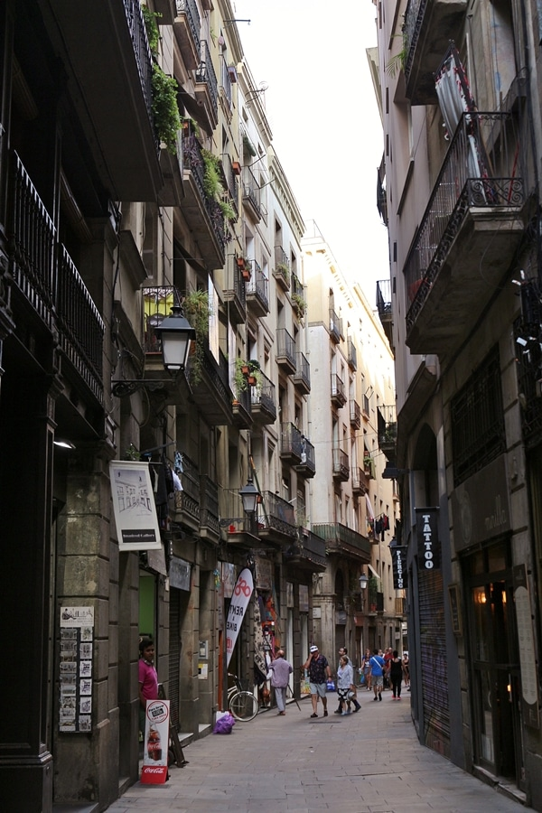 A narrow city street with people walking