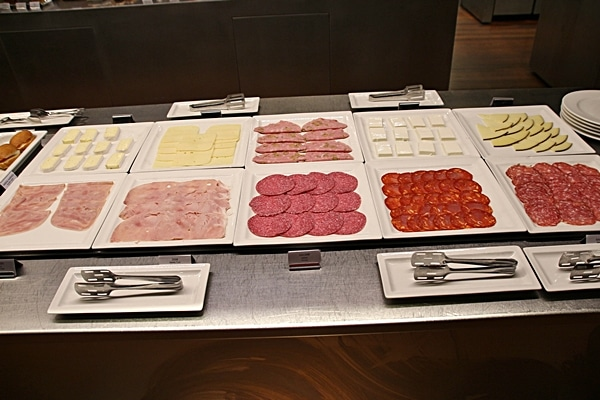 cured meats and cheeses on a buffet line