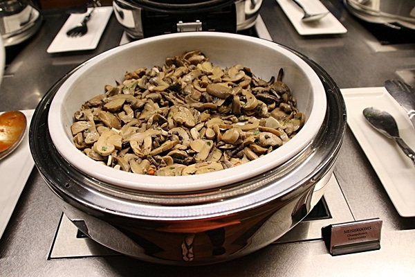 cooked mushrooms on a buffet line