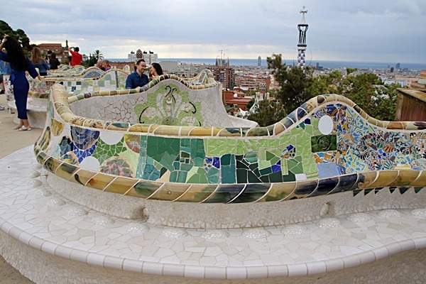 stone benches covered with mosaics in Park Güell