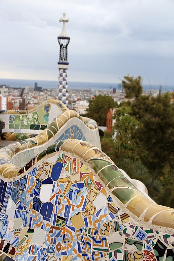 a closeup of mosaic covered benches in Park Güell