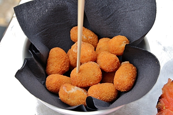 a dish of fried croquettes