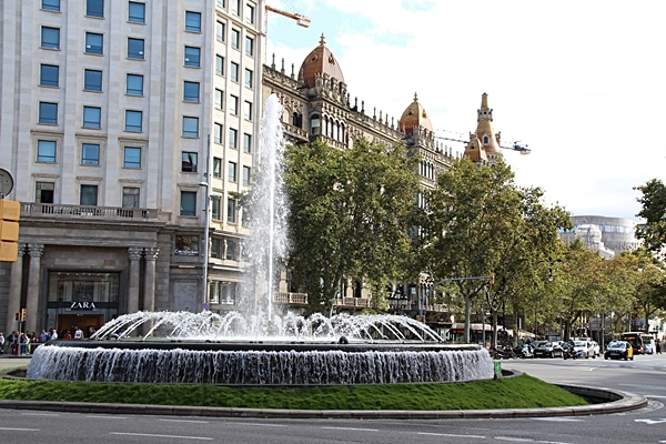 a large fountain on a city street
