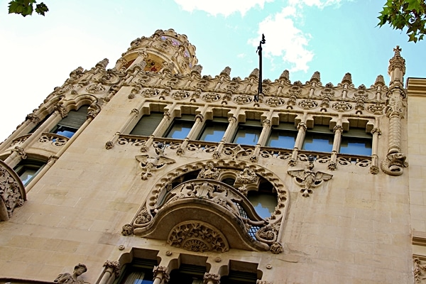 looking up at a building with stone carvings